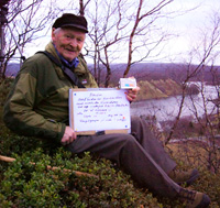 Kåre Sivertsen is doing his favorite work. In the picture he is holding the sign of the important data of one the findings close to Neiden.